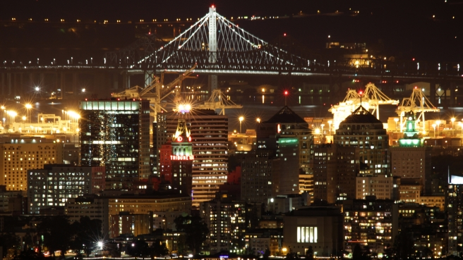 OAKLAND_CA_USA_-_Night_Skyline_with_Bay_Bridge
